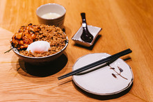 Chicken Yakitori Rice Bowl With Minced Pork Served With Chinese Steamed Egg, Spoon And Chopsticks.