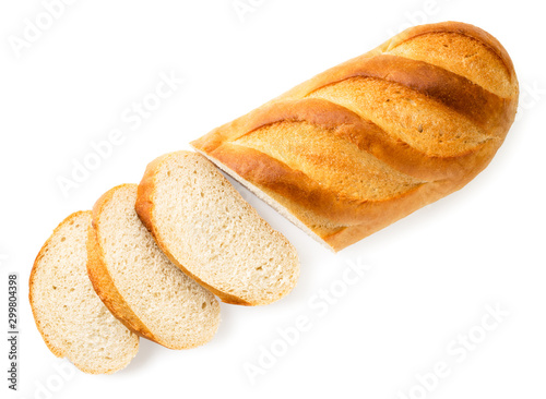Loaf of bread cut into pieces on a white. The view of the top. Fototapet