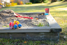 Colorful Toys At A Sandpit At Playground