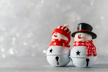 Two Toy Snowmen Stand Against ...