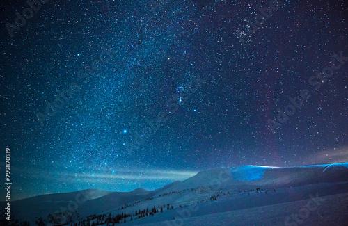 Stunning starry sky in a blue haze Canvas-taulu