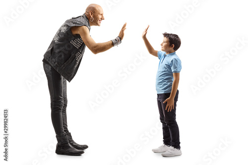 Valokuva  Punk gesturing high-five with a little boy