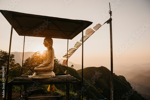 Foto op Canvas Historisch mon. Buddha statue on top of hill at Little Adam's Peak against sky during sunset, Sri Lanka