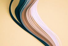 Close-up Of Quilling Papers On Beige Background