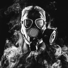 A Man In A Suit Gas Mask And Smoke