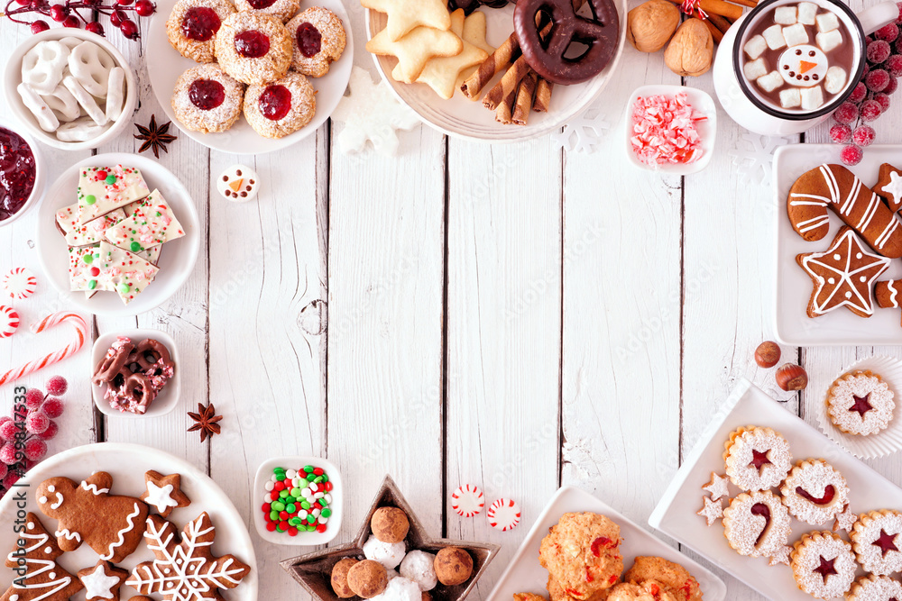 Fototapety, obrazy: Christmas sweets and cookie frame. Top view table scene over a white wood background with copy space. Holiday baking concept.