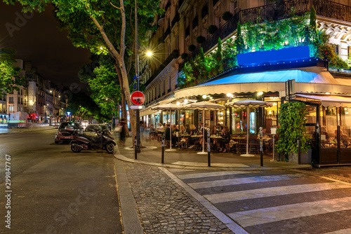 Fotografie, Obraz Boulevard San-German with tables of cafe in Paris at night, France