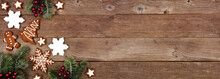 Christmas Gingerbread Cookies And Tree Branches. Above View Corner Border Banner On A Rustic Wood Background.