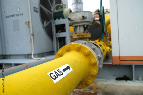 Fototapeta Yellow pipe labelled with the word GAS, process piping obraz