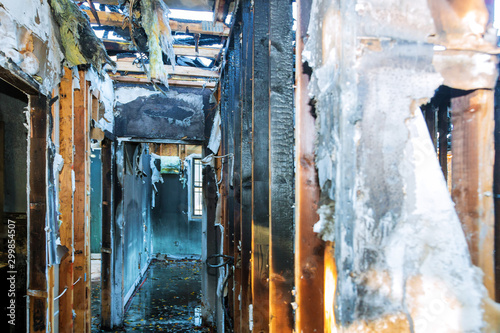Photo Burnt black house after fire damaged interior details arson from a home