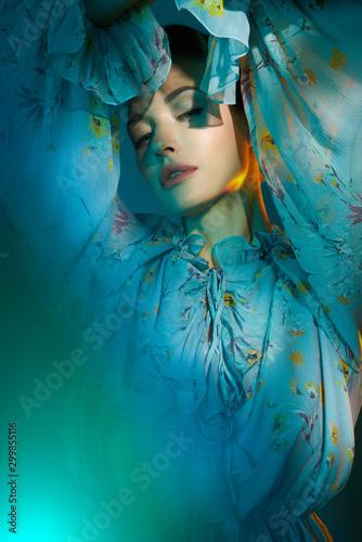 Foto op Canvas womenART Beautiful lady in blue chiffon dress