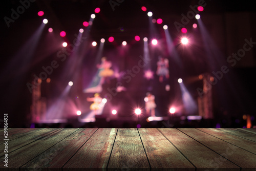 top wood desk with light bokeh in concert blur background,wooden table - 299864931