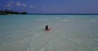 posing lady in white bikini in maldives sandbar