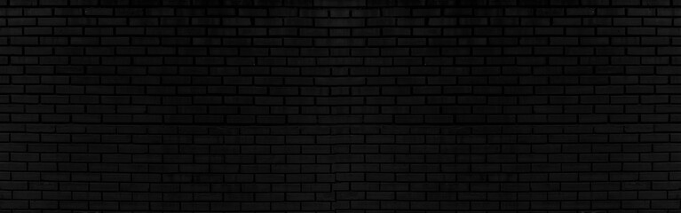 Abstract black brick wall texture for background or wallpaper design. panoram...