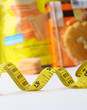Measuring tape against the background of sweet food. Diet and Weight lost concept