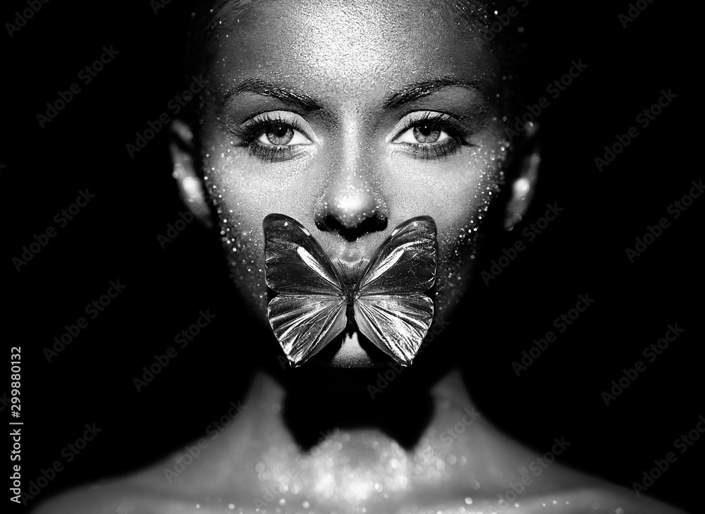 Fototapety, obrazy: Fashion model woman in bright sparkles and lights posing in studio. Portrait of beautiful sexy woman with butterfly. Art design glitter glowing make up. Black and white photography