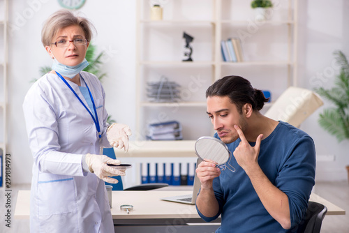 Fototapeta Young patient visiting doctor in hospital obraz na płótnie