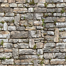 Seamless Masonry Texture Of The Wall Of Old Building Made Of Blocks Of Weathered Stone. Pisa. Italy.