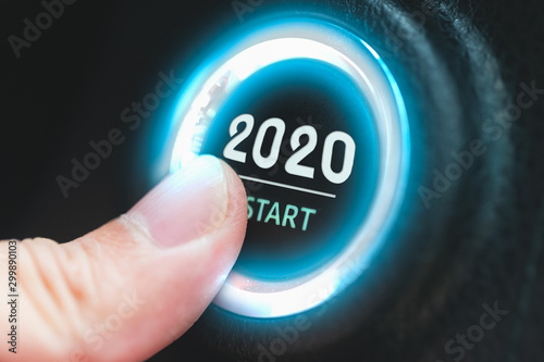 Finger pressing a 2020 start button. Concept of new year. Wallpaper Mural