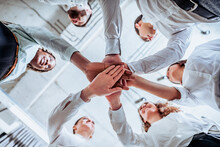 Underneath View, Business Teamwork Groups People Hands, Stacked Huddle Together, Unity International.