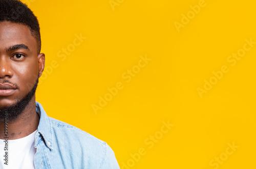 Half face portrait of confident handsome black guy