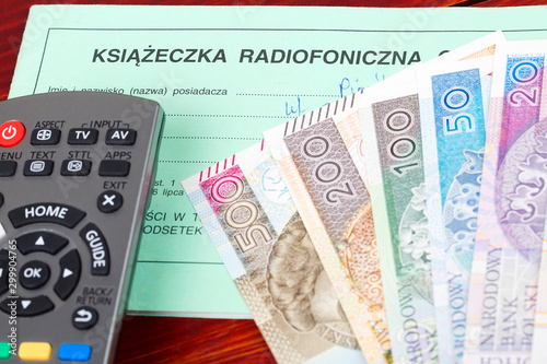 Fototapeta Polish TV subscription booklet with a remote control and money obraz