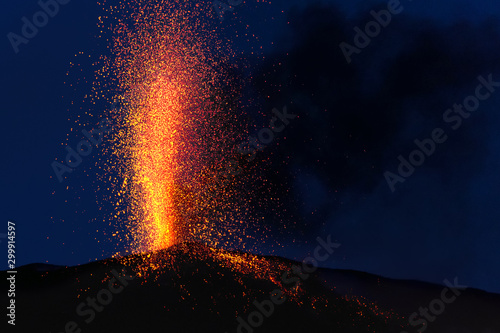 Obraz explosive eruption at dusk in one of the three craters of the active stromboli volcano, eolian islands, italy. - fototapety do salonu
