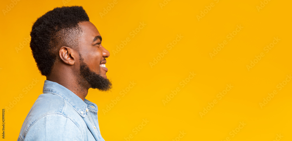 Fototapety, obrazy: Profile portrait of cheerful bearded black guy on yellow background