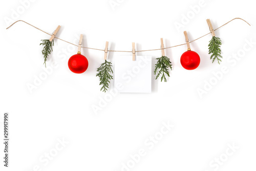 Poster Fleur Christmas composition on a white background. Sisal string, fir twigs, Christmas balls, place for your advertisement or text. Wooden laundry clips. copy space, top view, flat photo. December day and Ch