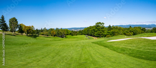 Deurstickers Pistache Golf Course with beautiful green field. Golf course with a rich green turf beautiful scenery.