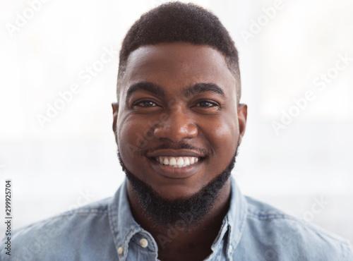 Closeup portrait of happy handsome african american man Wallpaper Mural