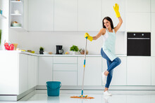 Full Length Photo Of Crazy Cheerful Gilr Wash Floor In Kitchen With Mop Want Have Relax Fun Imagine She Dances Clubbing Raising Hands Screaming Wearing Dotted Apron Indoors