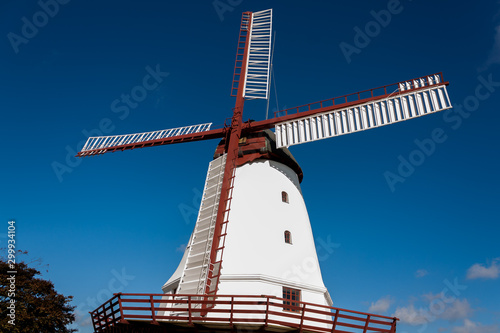 old windmill on background of blue sky