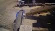 Asphalt plant outdoors. Aerial view on the modern equipment for asphalt production. Gravel moves up on conveyor.