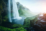 Perfect view of powerful Seljalandsfoss waterfall in sunlight. Location place Iceland, Europe.