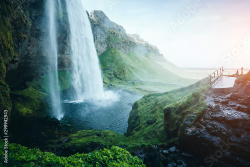 Perfect view of powerful Seljalandsfoss waterfall in sunlight. Location place Iceland, Europe. - 299942943