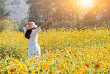 Asian Women With Blooming Flower In The Garden. Fresh Spring And Summer Floral Meadow. Natural Moment And Back To Nature For Peace And Serenity.