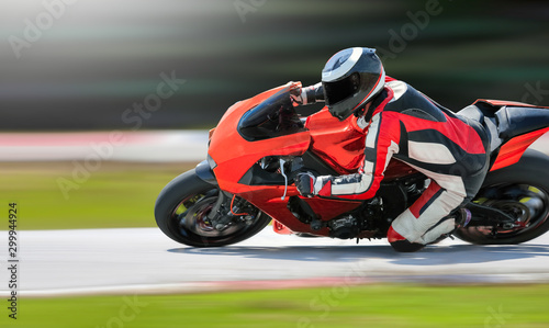 Fototapeta Motorcycle leaning into a fast corner on race track obraz