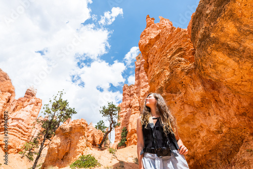 Young woman standing looking up at desert landscape summer view in Bryce Canyon Canvas Print
