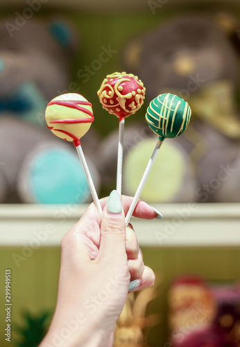 colorful cake-pops in hand