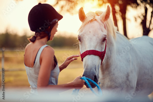 Summer day on the farm. woman caress horse