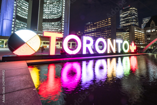 Nathan Phillips Square at night with Toronto Sign and City Hall Building