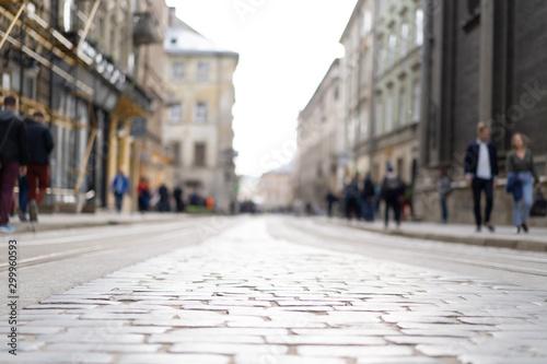 plakat tram rails, walking people in a big city, background, bluer, Lviv, Lisbon, Amsetrdam