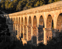 Tarragona Spain. Roman Ponte.Roman Aqueduct With Arches. Blue Sky With Sunset.