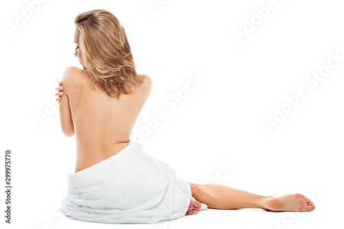 Garden Poster Spa Beautiful blonde woman in white towel on her hips sits naked back on white background.