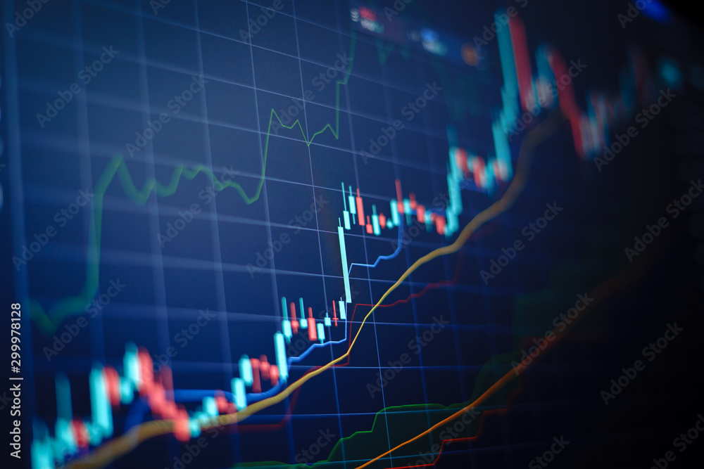Fototapety, obrazy: Closeup financial chart with uptrend line candlestick graph in stock market on blue color monitor background