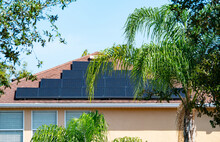 Solar Panel On A House Roof; Green Energy From Sun