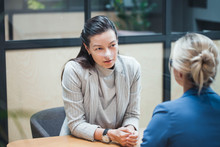 Job Interview Or Business Meeting Face - To-face. Two Business Women At A Meeting