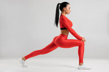 Fitness Woman Doing Lunges Exe...
