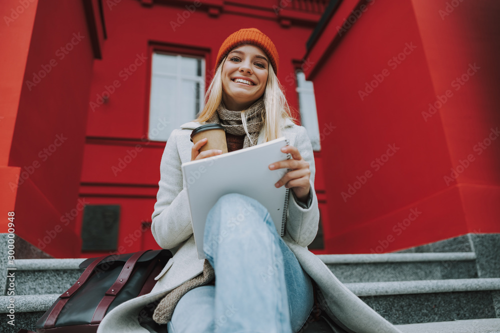 Fototapeta Young female student girl with copybook and coffee
